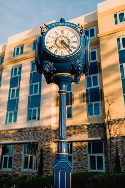 Old blue street clock with Roman numerals, quiz